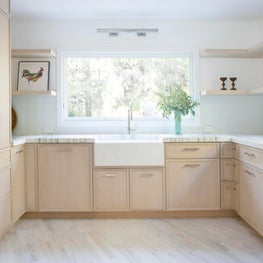 East Hampton Kitchen with Custom Cerused Oak Cabinetry with Farmhouse Sink and Marble Counter