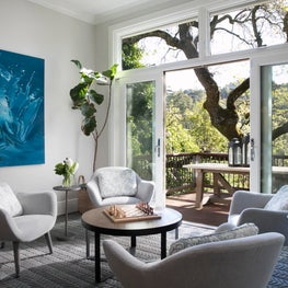 Interior living room with grey upholstered chairs and modern blue painting