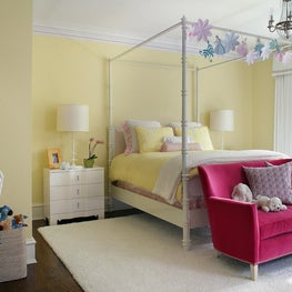 Girls Bedroom with canopy bed and magenta settee