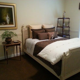 English Traditional Guest Bedroom in Neutral Colors for a sophisticated look.