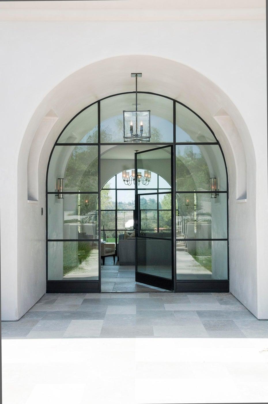 Arched steel doors at entry to Modern Mediterranean Rancho Santa Fe estate.