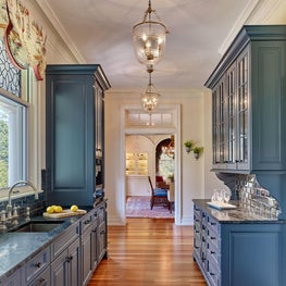 Clocktower Farm, New Butler's with Blue Cabinetry, Dark Countertops and Pendants