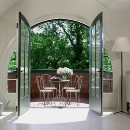 Curving Shingle Style Balcony with French doors