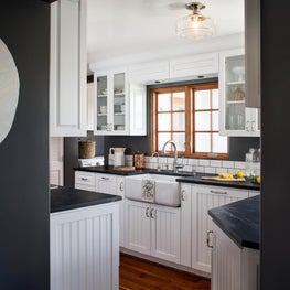 High contrast and classic neutrals makes this kitchen a clean slate for cooking!