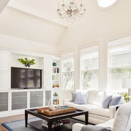 Cape Cod Living Room with White Sofa and Blue Rug in North San Mateo