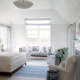 A simple planked ceiling and new fireplace for a beach house