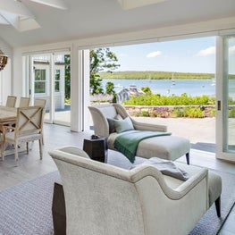 COASTAL SITTING AREA WITH OCEAN VIEWS, DISAPPEARING FOLDING GLASS DOORS