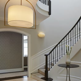 Foyer (Staircase Hall) With Curved Stairs & Light Hardwood Flooring