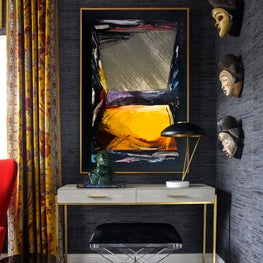 Writing Desk in Guest Bedroom with Colorful Accents and Art