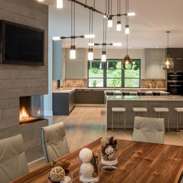 Open floor plan formal dining and contemporary kitchen in Transitional style
