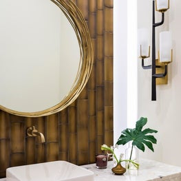 Modern family residence powder bath with floating Ann Sacks bamboo tile wall and shell quartz counters.