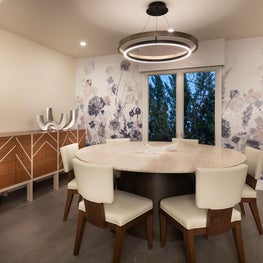 Open Plan Fusion - Patterned wall covering, custom white mahogany table, white leather chairs and mahogany sideboard