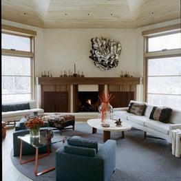 Geometric living room with natural wood ceiling, sleek seating