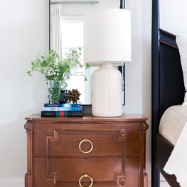New Traditional Residence master bedroom Modern History bedside chest with custom brass hardware and steel mirror.