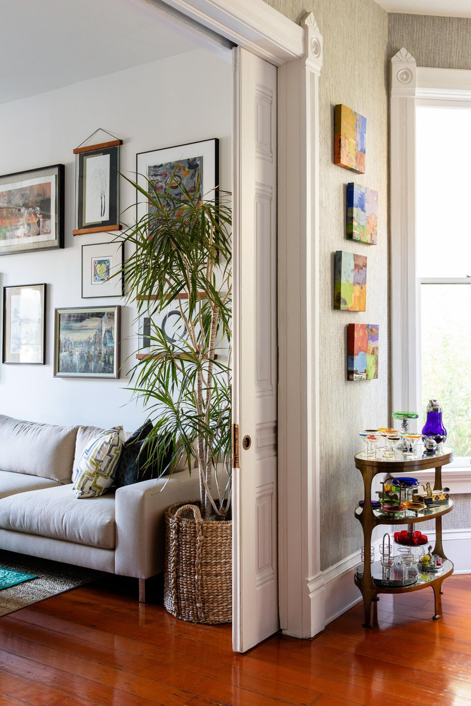 Just Passing Through:  Art-Filled Dining Room Leading to Living Room