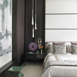 Modern, cozy bedroom with natural hues