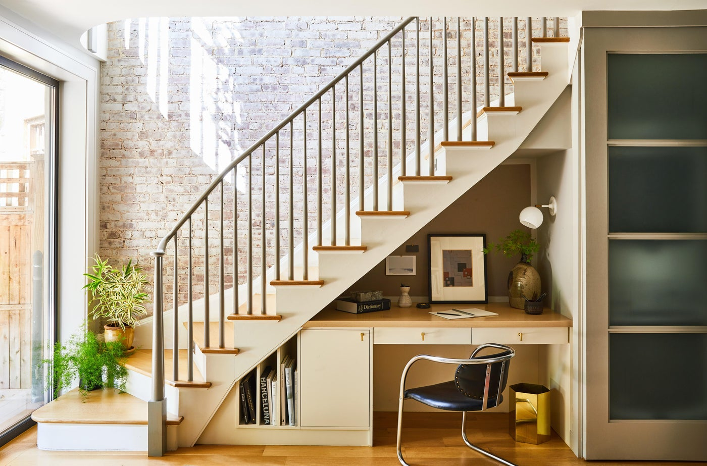 Hudson Street Brownstone I Staircase Nook | Exposed Brick | Office | Desk Nook