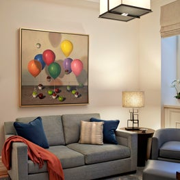 Playful artwork brightens this children's TV room.