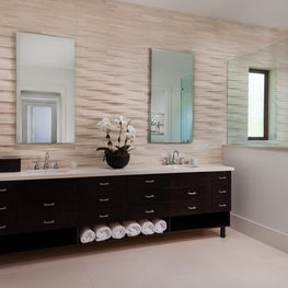 Three dimensional tile feature wall in master bathroom