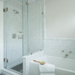 Marble mosaic tile walk-in shower and soaking tub