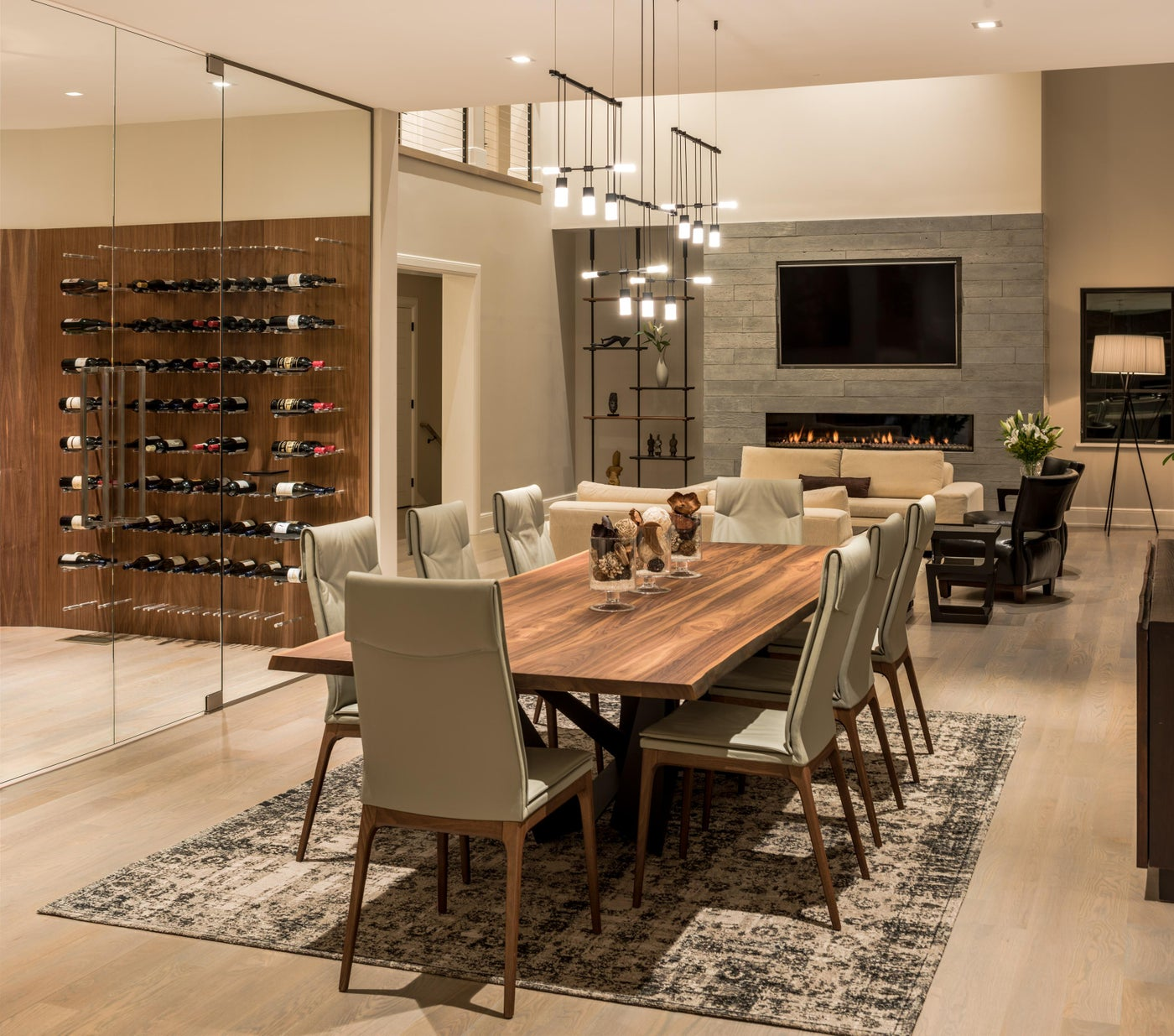 Contemporary dining room with glass wall wine room and open to living room