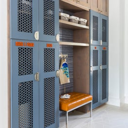 Family mudroom with customized lockers in a contemporary home design
