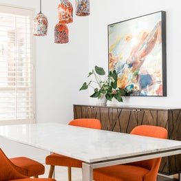 Dining rooms with orange accents - upholstered chairs & blown glass lighting
