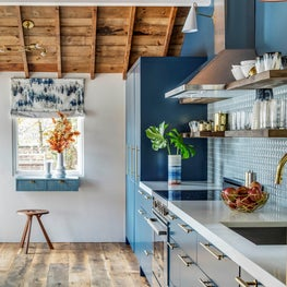 BLUE KITCHEN, WOOD CEILING, PILLOWED TILE, BRASS ACCENTS, RECLAIMED WOOD FLOORS,
