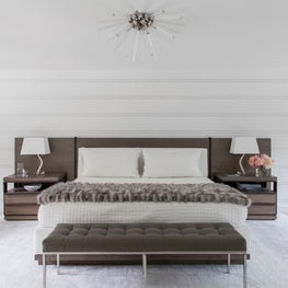 Gold Coast white bedroom with custom bed and burst light