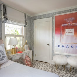 Girl's Bedroom with Large Chanel Print and Textured White Stools