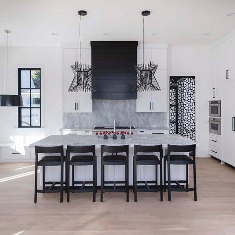 Pebbles Black Metal Pocket Door separates mudroom and kitchen