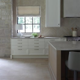 Kitchen with detail to tiling