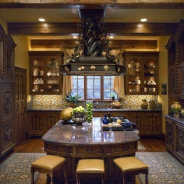This deliciously inviting Tuscan-styled kitchen provides an extraordinary work space for the owner's most robust culinary creations.