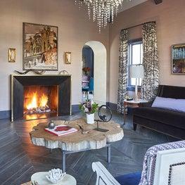 Custom Fireplace, Varied Width Wood Chevron Floor in Living Room
