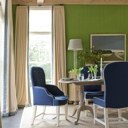 Preppy Dining Room with Green Painted Walls
