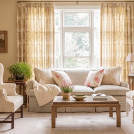 Living room in a coastal home with mix of antique and new furnishings