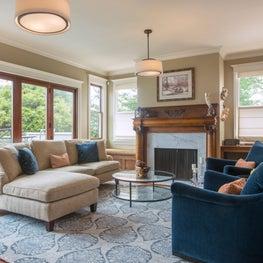 Living room with custom upholstery and indigo swivel chairs