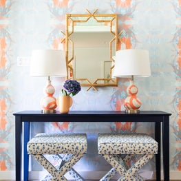 Abstract wallpaper & ceramic lamps make this entryway contemporary and tropical