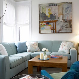 Art makes a bold statement in this light & airy family room