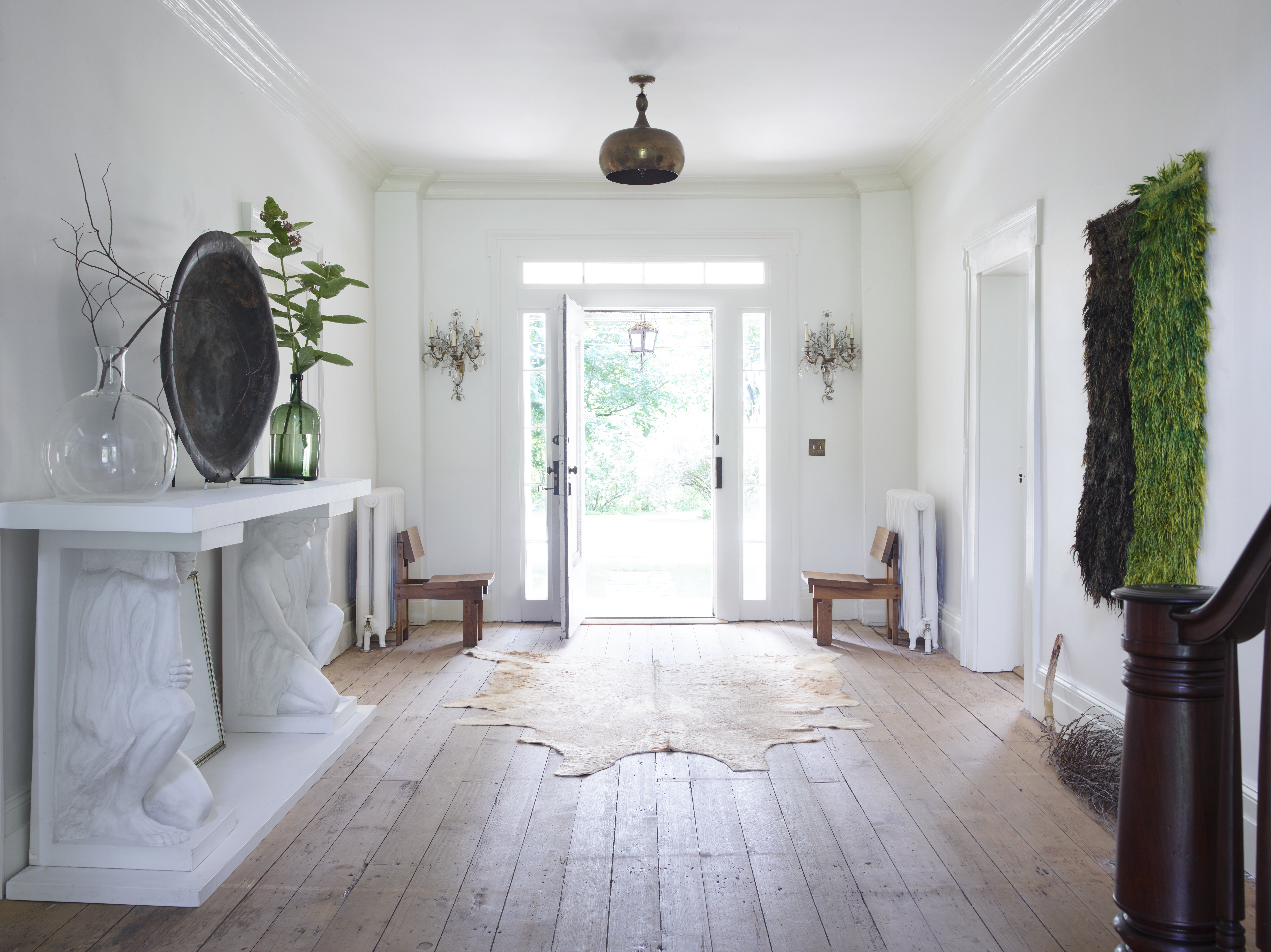 White painted walls provide a modern feel to this 18th century home. The raw wood floor throughout is original.