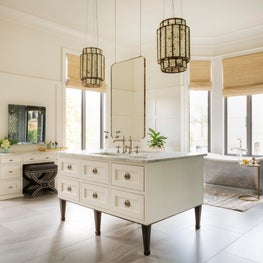 Horse Meadow country house master bathroom with custom floating vanity and antique pewter soaking tub.