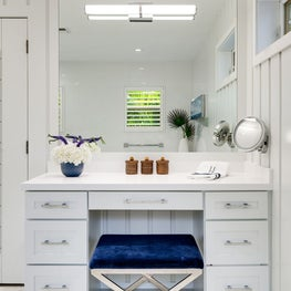 Crisp white Oceanside Cottage Master Bath Makeup Vanity area with shiplap wall panelling
