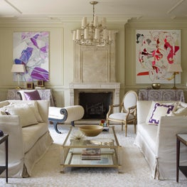 Chic neutral living room with bright art
