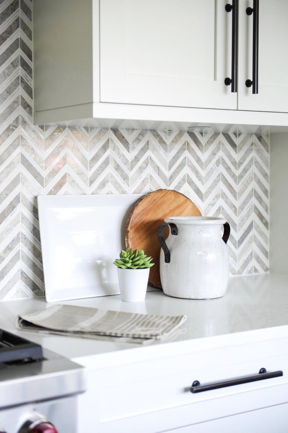 Modern kitchen with herringbone backsplash