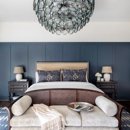 Stunning master bedroom with blue accents