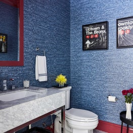 Bathroom with dark blue textured wallpaper