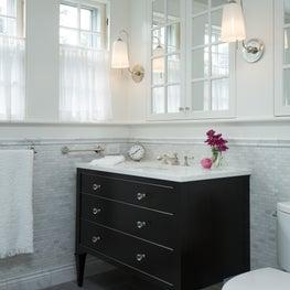 Mosaic tile bathroom with black furniture vanity