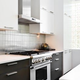 A completely rehabbed, contemporary kitchen in a condo built in the 1930's.