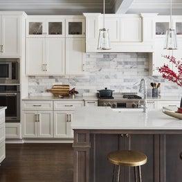White Kitchen with Quartz Countertop and Carrara Marble Backsplash