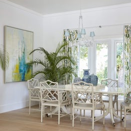 Tropical modern dining room with antique blue and white ceramic China collection